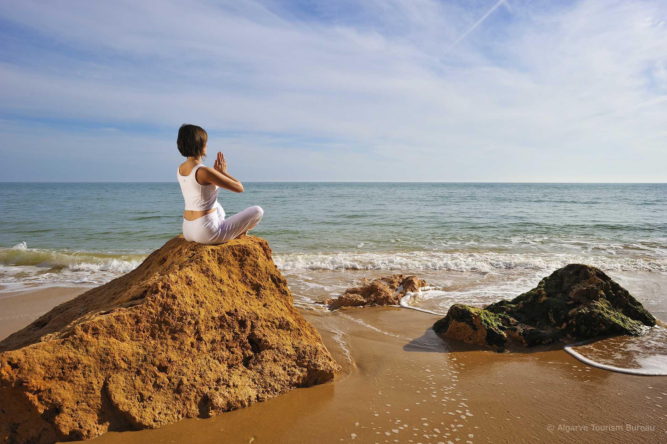 Meditating on beach in the Algarve