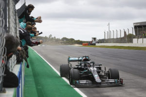 Lewis Hamilton chequered flag in the Algarve