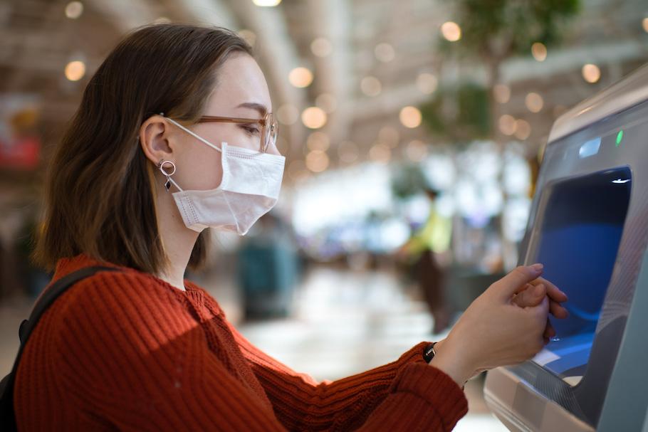 Passenger with airport hand sanitiser